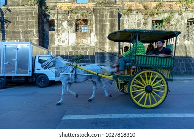 Manila, Philippines - Feb 17, 2018 : Running Horse with carriage with tourists in Intramuros district