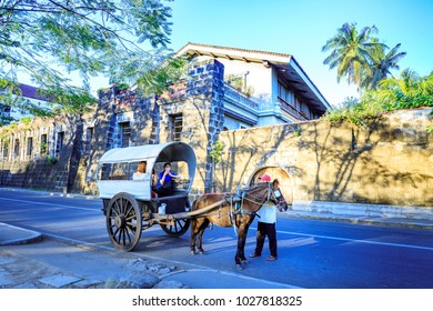 Manila, Philippines - Feb 17, 2018 : Horse with carriage waiting for tourists in Intramuros district