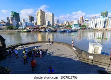 Manila, Philippines - Feb 17, 2018 : Tourist waching Manila pasig river view from Fort Santiago view deck, Intramuros, Manila, Philippines