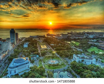 Manila, Philippines- February 05, 2019:  A breathtaking aerial view of Luneta Park with the famous Manila bay sunset behind.