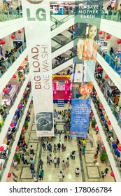 MANILA, PHILIPPINES - FEBRUARY 1, 2014: main hall at Farmers Plaza, shopping mall located in Araneta Center near Cubao Station. The asian mall offers 60,400 square meters of cheap merchandise outlets.