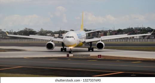 Manila, Philippines - February 2019: Cebu Pacific Airbus A330-300 exit roll from NAIA Runway 24.