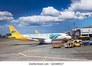 MANILA, PHILIPPINES - FEBRUARY 24: Cebu Pacific airpane in Manila airport on February, 24, 2013, Manila, Philippines. Its airline based on the grounds of Ninoy Aquino International Airport.