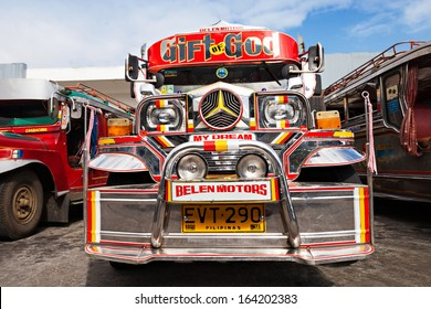 MANILA, PHILIPPINES - FEBRUARY 26: Jeepney on the bus station on February, 26, 2013, Manila, Philippines. Jeepney is a most popular public transport on Philippines.