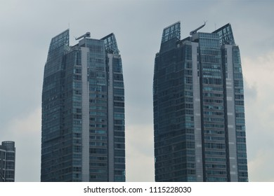 Manila, Philippines; February 5, 2018: The 60-storey St. Francis Shangri-la towers in Mandaluyong City. They are the first buildings in the world which are stabilized using outrigger dampers.