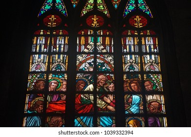 Manila, Philippines; February 6, 2018: A stained glass window inside the San Sebastian Church depicts a scene in the Gospel with Jesus, his apostles and a kneeling woman appearing to be Mary Magdalene