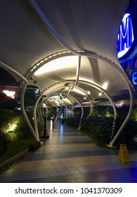 """Manila, Philippines; February 6, 2018: A covered walkway at the """"Sky Garden"""", an outdoor terrace area with restaurants and bars at the SM North Edsa shopping mall in Quezon City."""