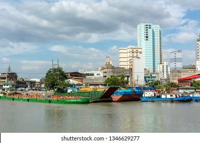 Manila, Philippines / January 1, 2019: Manila's cityscape view from Media Naranja the large semicircular gun platform in Fort Santiago, Intramuros district of Manila.