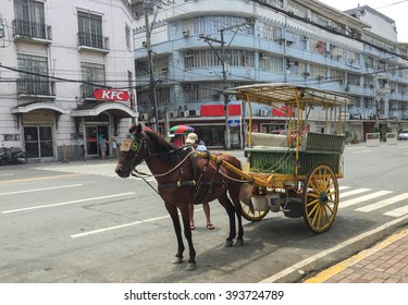 Manila, Philippines - July 19, 2015 : A Kalesa (or Horse Carriage) in Historic Town of Intramuros, Intramuros is the oldest district and historic core of Manila, Philippines