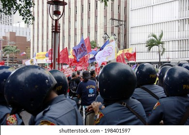 MANILA, PHILIPPINES- JUNE 12: Police stops the protester at The Philippines Independence day on June 12, 2014 in Manila. The Philippines celebrate the 116th Independence Day.