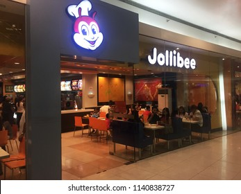 MANILA, PHILIPPINES - JUNE 17, 2018: Jollibee is a Filipino-style fast food restaurant with Italian-American dishes specializing in burgers, chicken and some local Filipino dishes.