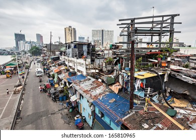 MANILA, PHILIPPINES - MARCH 18: Slum region on March, 18, 2013, Manila, Philippines. Manila is a Philippines capital with very strong contrasts in standard of living.