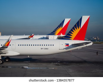 Manila, the Philippines - March 28, 2019: Two Philippine Airlines airliners, an Airbus A320 and an Airbus A330, at Ninoy Aquino International Airport, Terminal 2, in Manila.