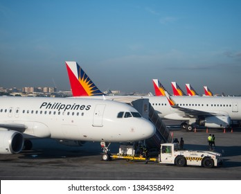 Manila, the Philippines - March 28, 2019: Airbus A320 and A321 airliners from Philippine Airlines at Ninoy Aquino International Airport, Terminal 2, in Manila.