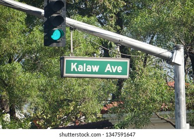 Manila, Philippines: March 7, 2019: A streetsign hanging next to traffic lights, found along T.M. Kalaw Avenue. The street is named after a late historian and legislator Teodoro M. Kalaw.