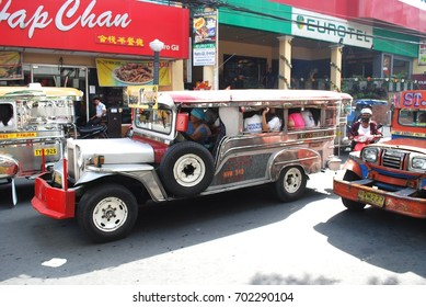 MANILA, PHILIPPINES - MAY 1: Jeepneys, sometimes called simply jeeps, are the most popular means of public transportation in the Philippines, in Manila, Phillipines, May 1, 2010.