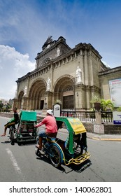 MANILA, PHILIPPINES - MAY 6: Tricycle taxi one of the most popular forms of transportation in Phillipines on May 6,2012 at Manila Cathedral in Intramuros district of Manila , Philippines.
