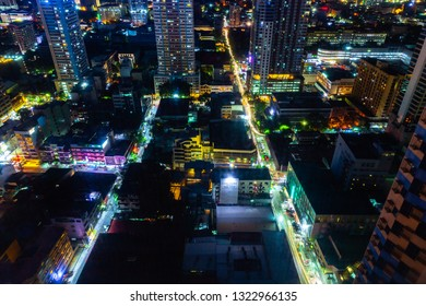 Manila, Philippines - November 11, 2018: Night view of the illuminated streets of the Malate district from above on November 11, 2018 in Metro Manila, Philippines.