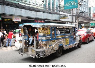 MANILA, PHILIPPINES - NOVEMBER 25, 2017: People ride a jeepney public transportation in Manila, Philippines. Metro Manila is one of the biggest urban areas in the world with 24 million people.