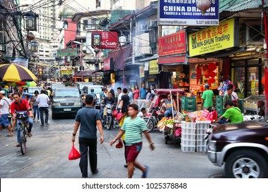 MANILA, PHILIPPINES - NOVEMBER 25, 2017: People visit Chinatown in Manila, Philippines. Metro Manila is one of the biggest urban areas in the world with 24 million people.
