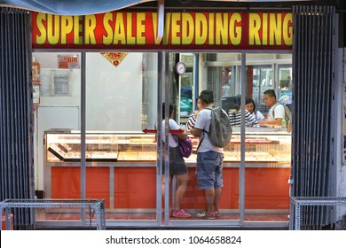MANILA, PHILIPPINES - NOVEMBER 25, 2017: People visit a wedding ring gold store in Manila, Philippines. Metro Manila is one of the biggest urban areas in the world with 24 million people.