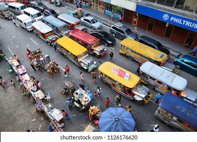 MANILA, PHILIPPINES - NOVEMBER 25, 2017: People drive in heavy traffic in Manila, Philippines. Metro Manila is one of the biggest urban areas in the world with 24 million people.