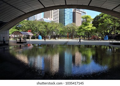 MANILA, PHILIPPINES - NOVEMBER 28, 2017: People visit Ayala Triangle in Makati City, Metro Manila, Philippines. Metro Manila is one of the biggest urban areas in the world with 24 million people.