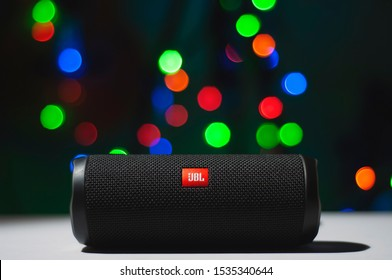 Manila, Philippines - October 18, 2019: JBL Flip 4 Bluetooth Portable Speaker close up Shot with Blurred or Bokeh Christmas Lights background.