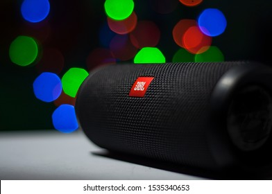 Manila, Philippines - October 18, 2019: Close up shot of the JBL Logo in JBL Flip 4 Bluetooth Portable Speaker with bokeh Christmas lights background.