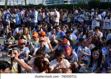 Manila, Philippines - October 22, 2017: Organized by social groups, huge crowd of young people gather at Color Manila Glitter Run festivity on city square, having fun.