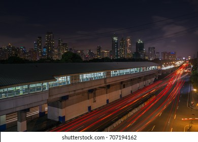 Manila, Philippines - September 1, 2017: Night landscape of EDSA road and Makati at background