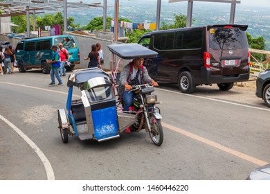 Manila, Philippines-May 24, 2019: Street scene of local lifestyle people using a Philippine tricycles on the street as a public transport with a cheap fare at Manila City, Philippine.