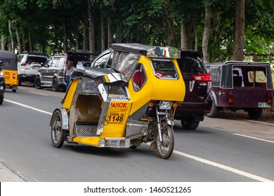 Manila, Philippines-May 24, 2019: Street scene of local lifestyle people using a Philippine tricycles on the street as a public transport with a cheap fare at Tagatay City, Philippine.