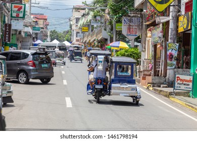 Manila, Philippines-May 24, 2019: Street scene of local lifestyle people using a Philippine tricycles on the street as a public transport with a cheap fare at Rural town, Philippine.