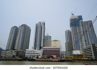 MANILA, Phillipines - APRIL 12 2018: The pasig river in makati passing by high rise condo buildings of Rockwell district