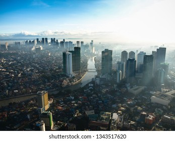 Manila, Phillipines - December2015: Skyline view of buldings, skyscrapers over a sunrise