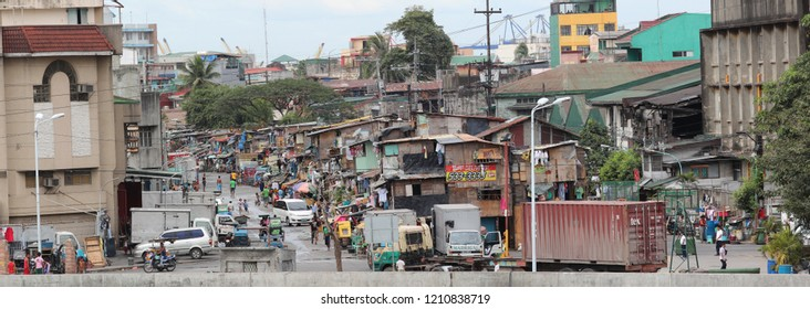 Manila, Phillippines - Feb 20, 2013: Slum area in Manila, Phillippines. The capital city is a city of contrasts between those that have and those who do not.