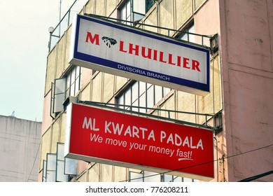 MANILA, PH-OCT 7:M Lhuillier Pawn Shop Divisoria branch  lighted signage on October 7, 2017 in Manila, Philippines.