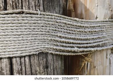 Manila rope around large wooden pole