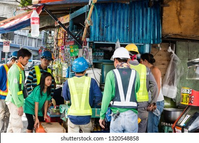 Manila/Philippines - February 2, 2019: construction workers buying food and drinks at sari sari store
