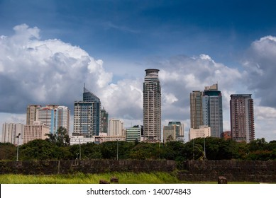 Manila's cityscape view from Baluarte de San Diego the circular fort one of the oldest stone fortifications on Intramuros district of Manila, Philippines.