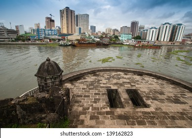 Manila's cityscape view from Media Naranja the large semicircular gun platform in Fort Santiago,  Intramuros district of Manila , Philippines.