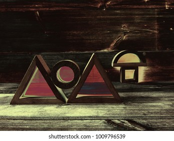 A Manipulated Photo Showing Wooden Shapes with Perspex Inserts Displayed at Different Angles on a Wood Grain Background