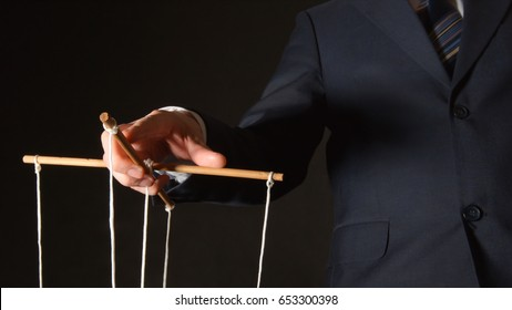 MANIPULATION: Businessman manipulating