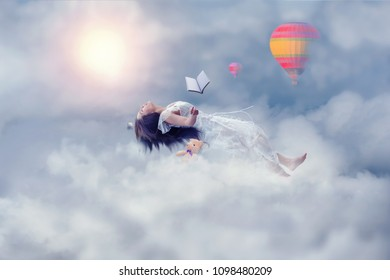 manipulation photo of dream concept, woman levitating over the clouds