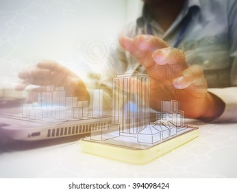 Manipulation of  Success businessman using digital tablet with drawing design building and social media diagram