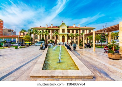 Manisa, Turkey - March 29, 2016 : People are relaxing in Emekliler Parki. Also Government House in background. Manisa was old Ottoman city in Turkey.