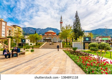 Manisa, Turkey - March 29, 2016 : People are relaxing in Emekliler Parki. Also Hatuniye Mosque in background. Manisa was old Ottoman city in Turkey.