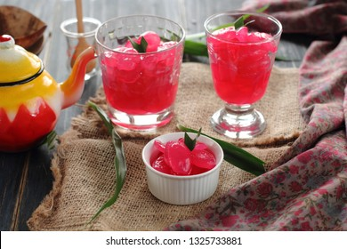 Manisan Kolang-Kaling, or preserved sugar palm fruit, tinted pinky red, served in bowl and glasses. An Indonesian typical refreshment and dessert during Ramadan month and in Idul Fitri or Hari Raya.