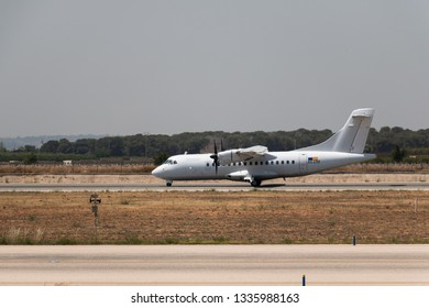 Manises, Spain - June, 2016: Twin-turboprop ATR 42 plane landing at Manises airport in Valencia, Spain